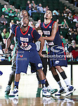 South Alabama Jaguars guard Tim Williams (33) and South Alabama Jaguars guard/forward Gary Redus (2) in action during the NCAA  basketball game between the South Alabama Jaguars and the University of North Texas Mean Green at the North Texas Coliseum,the Super Pit, in Denton, Texas. UNT defeated South Alabama 82 to 79...