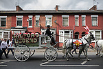 """© Joel Goodman - 07973 332324 . 28/08/2015 . Salford , UK . The procession passes along Liverpool Street , watched by people lining the pavements . The funeral of Paul Massey at St Paul's CE Church in Salford . Massey , known as Salford's """" Mr Big """" , was shot dead at his home in Salford last month . Photo credit : Joel Goodman"""