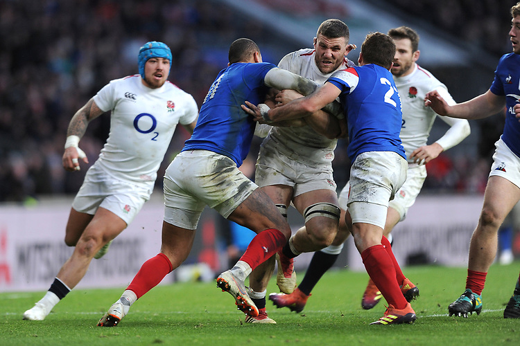 Mark Wilson of England is tackled by Guilhem Guirado and Gaël Fickou of France during the Guinness Six Nations match between England and France at Twickenham Stadium on Sunday 10th February 2019 (Photo by Rob Munro/Stewart Communications)