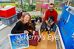 Artist Tina Reed with her husband Pat Rodgers and their dogs Molly and Eddie busy backing for their upcoming move