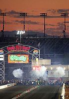 Nov 2, 2019; Las Vegas, NV, USA; The sun sets behind the track as NHRA top alcohol dragsters race during the Dodge Nationals at The Strip at Las Vegas Motor Speedway. Mandatory Credit: Mark J. Rebilas-USA TODAY Sports