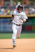 J.B. Shuck (30) of the Charlotte Knights hustles towards third base against the Gwinnett Braves at BB&T BallPark on May 22, 2016 in Charlotte, North Carolina.  The Knights defeated the Braves 9-8 in 11 innings.  (Brian Westerholt/Four Seam Images)