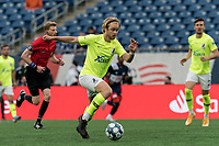 FOXBOROUGH, MA - MAY 12: Devin Boyce #20 of Union Omaha brings the ball forward during a game between Union Omaha and New England Revolution II at Gillette Stadium on May 12, 2021 in Foxborough, Massachusetts.