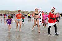 Pictured: People take part in this years Boxing Day Walrus Dip at Cefn Sidan, Llanelli, South Wales, UK. Wednesday 26 December 2018<br /> Re: Hundreds of people take part in this year's Boxing Day Walrus Dip at Cefn Sidan, Llanelli, South Wales, UK