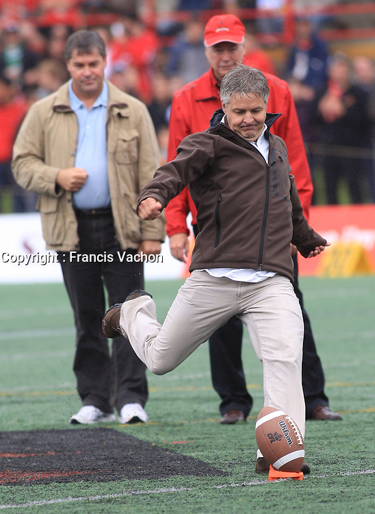 Quebc city 400th anniversary comity president Daniel Gelinas proceed to the official kick off before a Rouge et Or football game against the Carabins de l'Universite de Montreal at the Universite Laval stadium in Quebec City, September 7, 2008. Laval won 17-6 before a crowd of 15,275.<br /> <br /> PHOTO :  Francis Vachon - Agence Quebec Presse