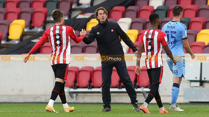 Brentford Manager, Thomas Frank shakes hands with Mathias Jensen at the final whistle during Brentford vs Coventry City, Sky Bet EFL Championship Football at the Brentford Community Stadium on 17th October 2020