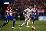 Lucas Vazquez of Real Madrid is followed by Koke of Atletico de Madrid during their La Liga match between Atletico de Madrid and Real Madrid at the Vicente Calderón Stadium on 19 November 2016 in Madrid, Spain. Photo by Diego Gonzalez Souto / Power Sport Images