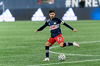 FOXBOROUGH, MA - NOVEMBER 20: Carles Gil #22 of New England Revolution passes the ball during the Audi 2020 MLS Cup Playoffs, Eastern Conference Play-In Round game between Montreal Impact and New England Revolution at Gillette Stadium on November 20, 2020 in Foxborough, Massachusetts.