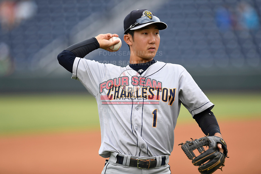 Shortstop Hoy Jun Park (1) of the Charleston RiverDogs warms up prior to a game against the Greenville Drive on Thursday, July 27, 2017, at Fluor Field at the West End in Greenville, South Carolina. Charleston won, 5-2. (Tom Priddy/Four Seam Images)