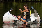 COLEBROOK, CT--- -090515JS09- Amy D'Amore of Main Stream Canoes and Kayaks in New Hartford, paddles her two son's Braylen, 4, and Cohen, 7, through the course during the annual Colebrook Fair's cardboard boat regatta Saturday at the Colebrook Town Pond. <br />  Jim Shannon Republican-American