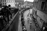 peloton entering the french town of Cassel<br /> <br /> 77th Gent-Wevelgem 2015