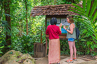 Thailand, Mae Hong Son. Women from Karen tribe trained to work at the Fern Resort. Som showing guest where to hike on the property.