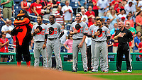 24 May 2009: Members of the Baltimore Orioles stand with the Orioles' mascot during the singing of the National Anthem prior to facing the Washington Nationals at Nationals Park in Washington, DC. The Nationals rallied to defeat the Orioles 8-5 and salvage a win in their interleague series. Mandatory Credit: Ed Wolfstein Photo