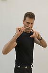 Uri Geller at home Berkshire England 2008. Bending spoon taken on a Nikon camera motor drive, images are timed in my camera. Bending spoon 2nd image taken at 16. 36. 04 pm.