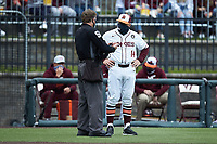 Virginia Tech Hokies head coach John Szefc (14) has a discussion with home plate umpire Greg Howard during the game against the Georgia Tech Yellow Jackets at English Field on April 17, 2021 in Blacksburg, Virginia. (Brian Westerholt/Four Seam Images)