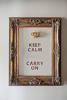 Artwork on the wall 'Keep Calm and Carry On' at Nicole Bekdache's home, Grasse, France, 30 March 2012. She found the crown in a second-hand shop in Grasse and used a frame from an old painting. She has yet to stencil the word 'AND' on the wall to finish the piece.