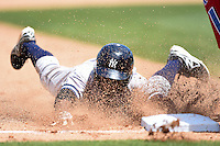 Tampa Yankees outfielder Claudio Custodio (6) slides into third base during a game against the Clearwater Threshers on April 9, 2014 at Bright House Field in Clearwater, Florida.  Tampa defeated Clearwater 5-3.  (Mike Janes/Four Seam Images)