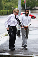 "Pictured: Peter Shodeinde (R) arrives at Cardiff Crown Court, Cardiff, Wales, UK. Friday 27 September 2019<br /> Re: Two men who handcuffed another to a radiator for over 24hrs have are due to be sentenced by Cardiff Crown Court, Wales, UK.<br /> Peter Shodeinde and Sochi Ezeemo, both 27, collected the man from Bristol and brought him to a house in Treforest. <br /> Ezeemo contacted the brother of the victim in Nigeria demanding money they said was owed to them. Police in the UK were contacted by the victim's brother telling them about the demands. <br /> When police raided the house where they believed the victim was being held prisoner, they found him injured and handcuffed to a radiator.  <br /> Shodeinde claimed that he was part not of the kidnapping and false imprisonment but evidence presented by the CPS was able to prove that he was. <br /> Kelly Huggins, of the CPS, said: ""The victim suffered appalling treatment whilst being kept prisoner, being beaten, deprived of sleep and enduring acts of humiliation such as shaving off his hair.<br /> ""It is difficult to imagine how frightening this horrible experience would have been for the victim.<br /> ""Now that the case has concluded, we hope it will help him move forward in his healing process."""