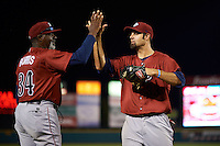 Lehigh Valley IronPigs outfielder Jordan Danks (33) high fives pitching coach Ray Burris (34) after a game against the Rochester Red Wings on July 4, 2015 at Frontier Field in Rochester, New York.  Lehigh Valley defeated Rochester 4-3.  (Mike Janes/Four Seam Images)