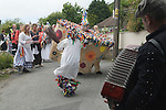 Hunting the Earl of Rone. Combe Martin Devon England.  2011. The Hobby Horse dancing through the streets of the village.
