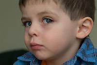 boy in blue flannel shirt
