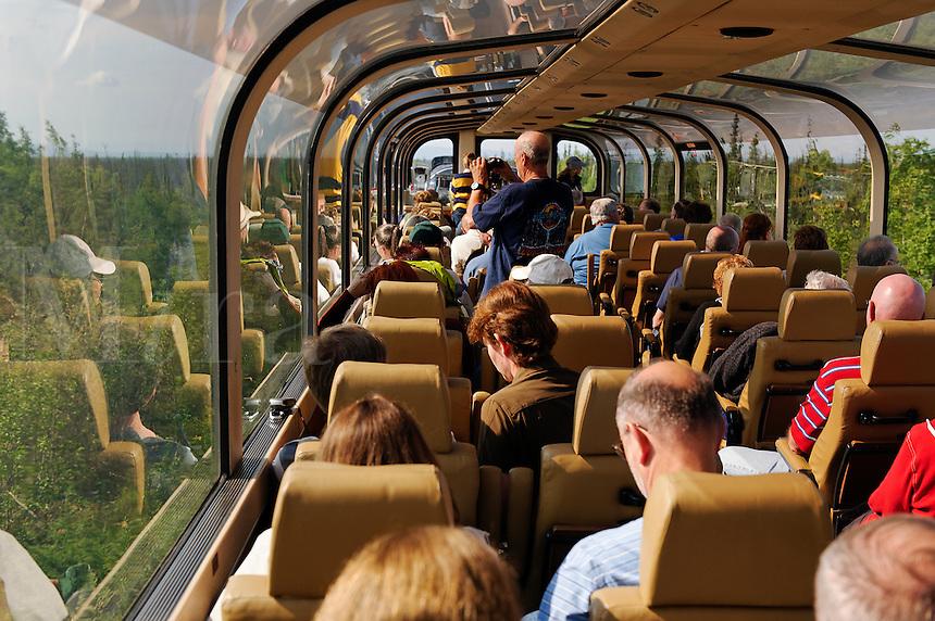 Tourists enjoy panoramic views aboard a double decker train car on the Alaska Railroad system, Alaska