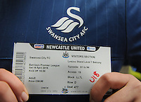 A Swansea City fan holds his ticket before kick off during the Barclays Premier League match between Newcastle United and Swansea City played at St. James' Park, Newcastle upon Tyne, on the 16th April 2016