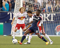 New England Revolution midfielder Clyde Simms (19) passes ball during build-up as New York Red Bulls midfielder Mehdi Ballouchy (10) defends. In a Major League Soccer (MLS) match, New England Revolution defeated New York Red Bulls, 2-0, at Gillette Stadium on July 8, 2012.
