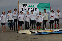 Pacific Beach, San Diego CA, USA.  Wednesday, January 23 2013:  Members of the PB Locals Surf Club from PB Middle School pose near tower 27 before heading out into the water for an afternoon training session.  The after school team meets every Wednesday about two hours before sunset to train for weekend competitions.