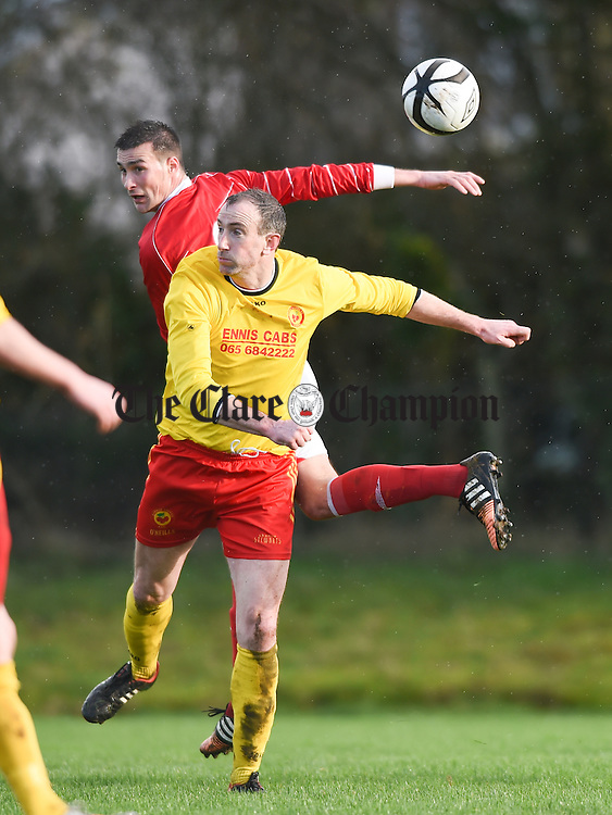 David Russell of Avenue United in action against Stephan Kelly of Newmarket Celtic during their Munster Junior Cup game in Roslevan. Photograph by John Kelly.