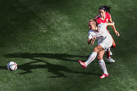 June 21, 2015: Lia WAELTI of Switzerland kicks the ball during a round of 16 match between Canada and Switzerland at the FIFA Women's World Cup Canada 2015 at BC Place Stadium on 21 June 2015 in Vancouver, Canada. Canada won 1-0. Sydney Low/Asteriskimages.com