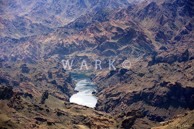 Colorado River flowing through rugged desert terrain