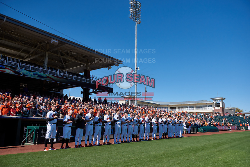 Oregon State Beavers manager Mitch Canham (11) stands at attention with his team during the National Anthem before an NCAA game against the New Mexico Lobos at Surprise Stadium on February 14, 2020 in Surprise, Arizona. (Zachary Lucy / Four Seam Images)