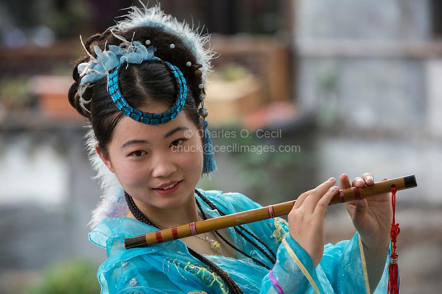 Suzhou, Jiangsu, China.  Young Chinese Woman Posing for her Picture in Tongli Ancient Town near Suzhou.