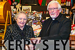 Listowel Bizarre: Mary Lyons from listowel receiving her cheque for €500.00 from Fr. Sean Sheehy at the annual Listowel bizarre at Scoil Realta na Madna, Listowel on Saturday night last.