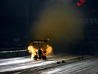 Aug 30, 2014; Clermont, IN, USA; NHRA top fuel driver Clay Millican explodes an engine on fire during qualifying for the US Nationals at Lucas Oil Raceway. Mandatory Credit: Mark J. Rebilas-USA TODAY Sports