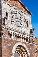 13th century Rose window, sculptures and loggia on the facade of the 8th century Romanesque Basilica church of St Peters, Tuscania, Lazio, Italy