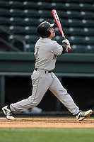 Designated hitter Erik Samples (1) of the USC Upstate Spartans bats in a game against the Furman University Paladins on Tuesday, March 4, 2013, at Fluor Field at the West End in Greenville, South Carolina. Furman won, 13-1. (Tom Priddy/Four Seam Images)