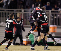 DC United's Joshua Gros gets mobbed by teammates Alecko Eskandarian, Freddy Adu, and Ben Olsen after scoring the game winning goal. D.C. United defeated Harbour View F. C. 2 to 1 in quarterfinals action of The CONCACAF Champions Cup at Maryland SoccerPlex, Boyds, MD, on March 9, 2005.