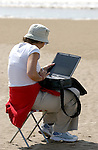 Working with a laptop on a beach in England
