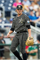 Vanderbilt Commodores pitcher Carson Fulmer (15) in action during the NCAA College baseball World Series against the Cal State Fullerton Titans on June 14, 2015 at TD Ameritrade Park in Omaha, Nebraska. The Titans were leading 3-0 in the bottom of the sixth inning when the game was suspended by rain. (Andrew Woolley/Four Seam Images)