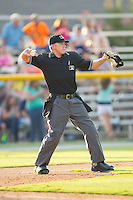 Home plate umpire Matt Davis throws a new baseball to the pitcher during the Appalachian League game between the Greeneville Astros and the Burlington Royals at Burlington Athletic Park on June 29, 2014 in Burlington, North Carolina.  The Royals defeated the Astros 11-0. (Brian Westerholt/Four Seam Images)