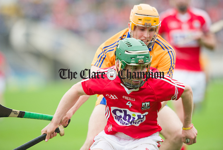 Barra O Tuama of Cork in action against Stephan Ward of Clare during their Intermediate hurling game at Thurles. Photograph by John Kelly.