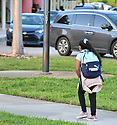 PEMBROKE PINES, FLORIDA - AUGUST 18: 8 year old Isabella walk to school with her mother as Faculty greet students arriving for the first day of classes at Broward County school in Pembroke Pines, Florida, U.S., on Wednesday, August 18, 2021.  Florida State Board of Education said it would force defiant school districts to comply with Republican Governor Ron DeSantis executive order forbidding them from mandating students wear masks as a way to slow a surge in Covid-19 cases.  ( Photo by Johnny Louis / jlnphotography.com )