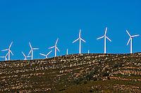 Wind turbines on ridge above the Playa De Los Lances, Tarifa, Andalusia, Spain.