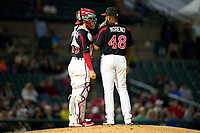 Rochester Red Wings catcher Tres Barrera (13) talks with pitcher Diego Moreno (48) during a game against the Worcester Red Sox on September 4, 2021 at Frontier Field in Rochester, New York.  (Mike Janes/Four Seam Images)
