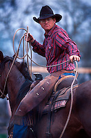 Portrait of a cowboy with a lariat atop a horse. South Dakota.