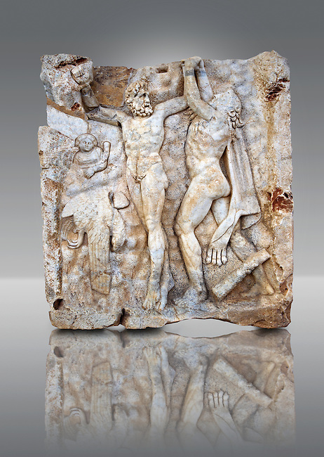 Photo of Roman relief sculpture, Aphrodisias, Turkey, Images of Roman art bas reliefs.  Prometheus is screaming in pain. Zeus had given him a terrible punishment for giving fire to man: he was tied to the Caucasus mountains and had his liver picked out daily by an eagle. Herakles shot the eagle and is undoing the first manacle. He wears his trade mark lion-skin and thrown his club to one side. A small mountain nymph, holding a throwing stick appears amongst the rocks.