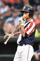 Shortstop Andres Gimenez (13) of the Columbia Fireflies kisses his bat in a game against the Rome Braves on Monday, July 3, 2017, at Spirit Communications Park in Columbia, South Carolina. Columbia won, 1-0. (Tom Priddy/Four Seam Images)