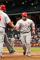 Philadelphia Phillies catcher Carlos Ruiz #51 is greeted by Pete Orr during the Major League Baseball game against the Houston Astros at Minute Maid Park in Houston, Texas on September 13, 2011. Houston defeated Philadelphia 5-2.  (Andrew Woolley/Four Seam Images)